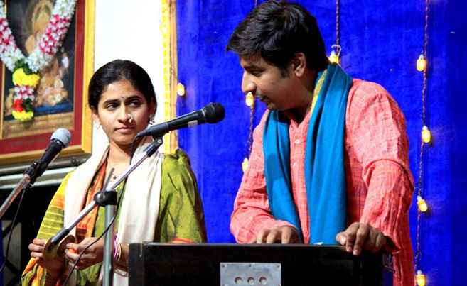 Mandar and Dakshayani doing a Kirtan